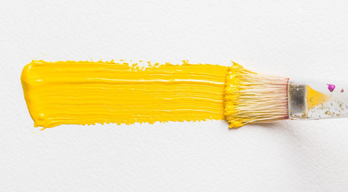 brush painting with yellow color scaled